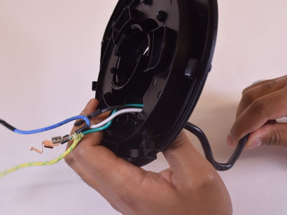 Discard the old power cord and insert the new power cord by following these instructions in reverse.