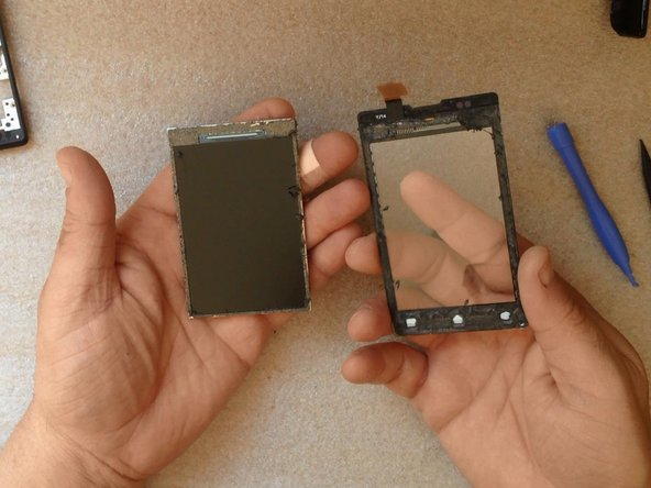 Clear the LCD Display from the old adhesive tape.