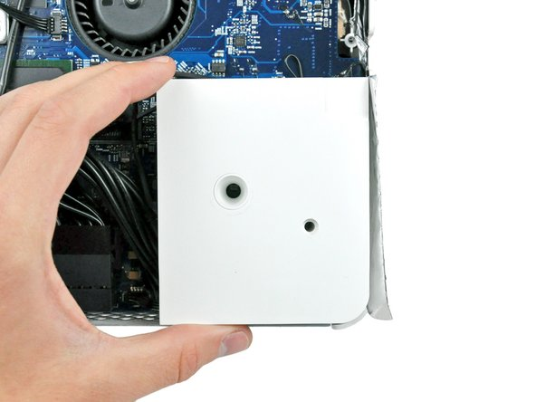 Lift the right speaker out of the iMac and let it hang down as you work on the Bluetooth board.