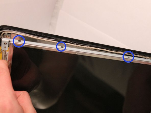 Gently pull the back panel approximately 1 inch away from the screen.