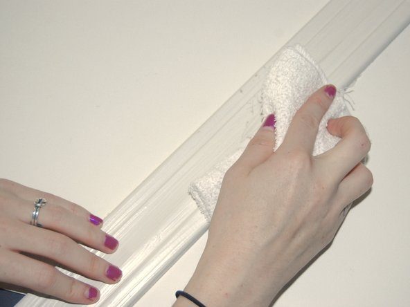 Wipe off the excess dust from sanding with a wash cloth.