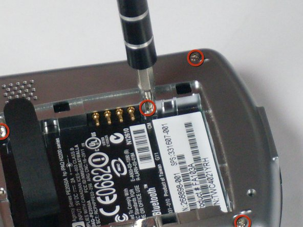 Using the T5 Torx screwdriver,  remove all six screws on the back and all screws on each side of the device.