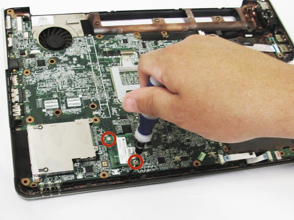 Image 1/2: Do not try to remove the modem card from the laptop, it is still attached to the modem connector on the underbody.