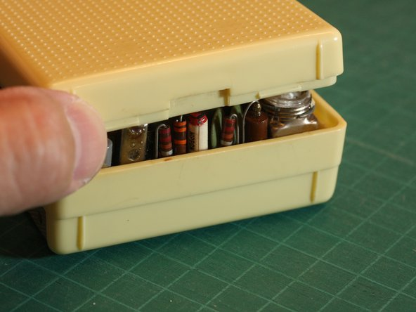 Image 1/2: Carefully pry open the case from the bottom edge.