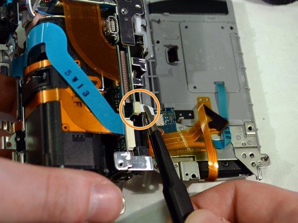 Unplug the small white ribbon wire.