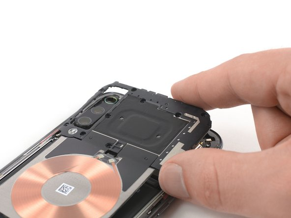 Carefully remove the motherboard cover including the charging coil / NFC antenna.