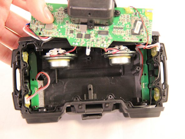 Gently pull the battery from the housing of the device while disconnecting the red, white and black wires coming from the battery.