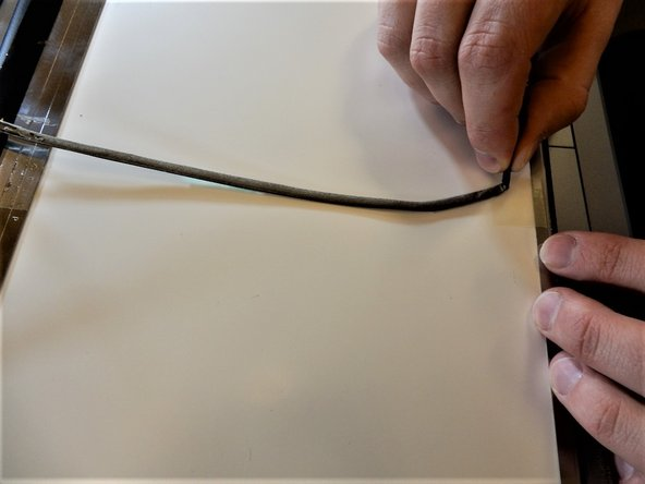 Remove the tape, and unplug the display cable on the back of the screen.