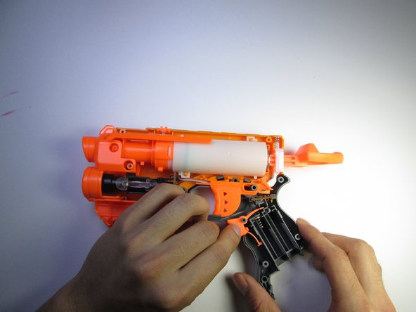 Remove the laser trigger by grabbing the trigger with your fingers and pulling it up and out.
