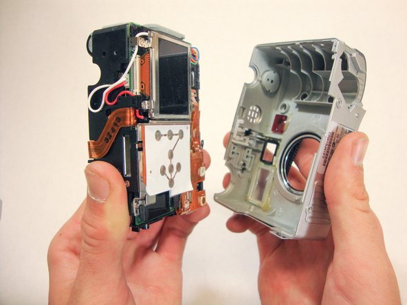Once the bottom of the inner camera is pulled out about an inch and a half, pull the device out completely.