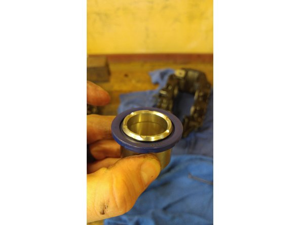 Put a bit of assembly lube on the piston and slowly but firmly insert the piston into the proper hole until seated all the way in. The pistons are different sizes on this model, so be aware of the difference and placement in the proper area.