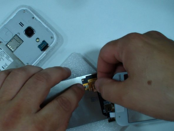 Connect the touch screen to the LCD flex cable.