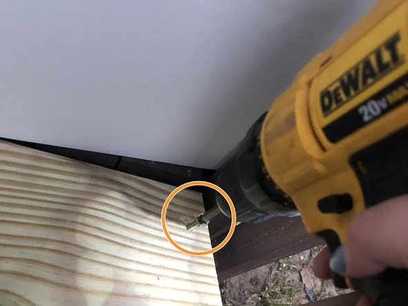 """Secure the wood (tread) into place by drilling 2"""" galvanized Phillips head screws into the pilot holes."""
