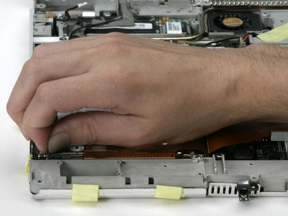 If you have already removed the hard drive, ignore its presence in the following steps. The hard drive does not affect the display removal.