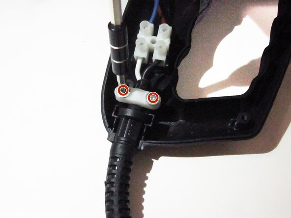 Remove the two 12mm screws from the base of power cord using the PH#0 screwdriver.