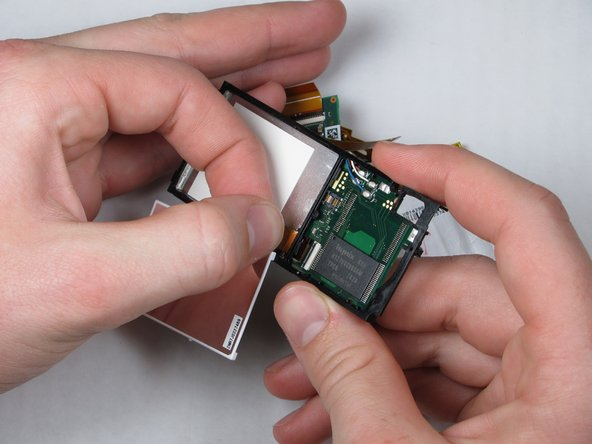 Remove the LCD by carefully pulling directly on the ribbon.