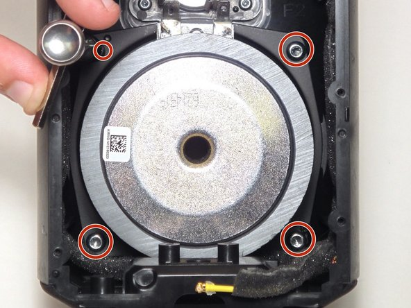 Using the Torx T20 bit remove the four 13 mm screws fastening the speaker to the housing.