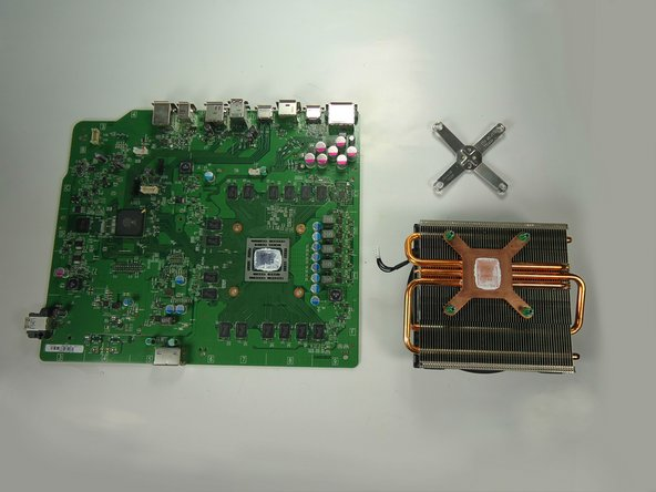 Lift the motherboard free of the fan and heat sink and set aside.