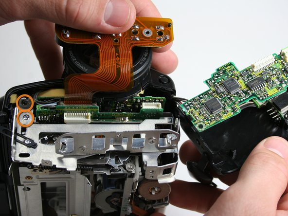 Remove two remaining case screws on the front of the camera 2x3.63mm.