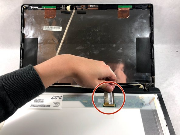 Disconnect the display cable connector attached to the display.