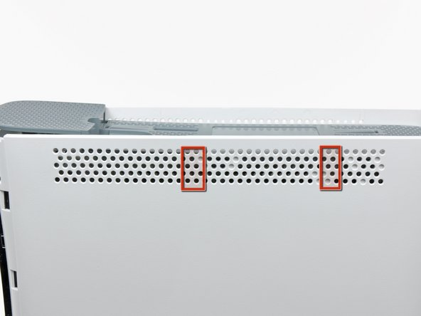 In the next few steps, you will use the tip of a spudger or the finger of an Xbox 360 opening tool to release the clips along the left and right sides of the top vent. Their locations are highlighted in red.