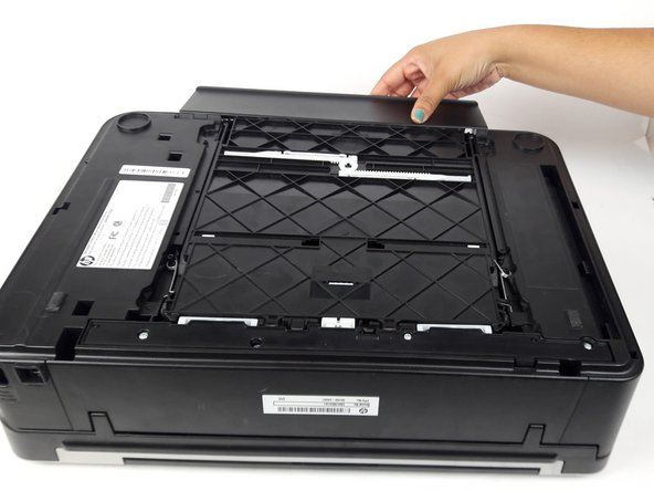 Remove paper tray by pulling it out and away from the printer.