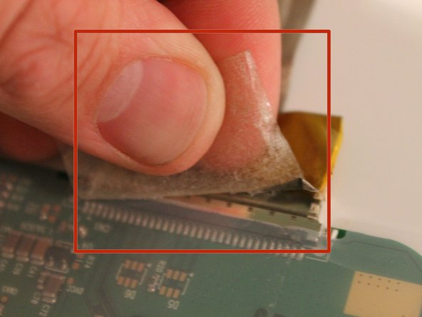 Image 2/3: Carefully remove the ribbon cable by pulling it out of it's socket.
