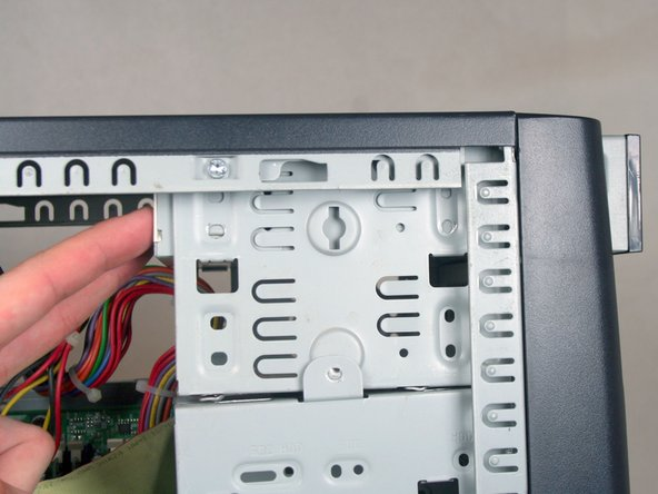 Remove the optical drive by sliding it out the front of the device.