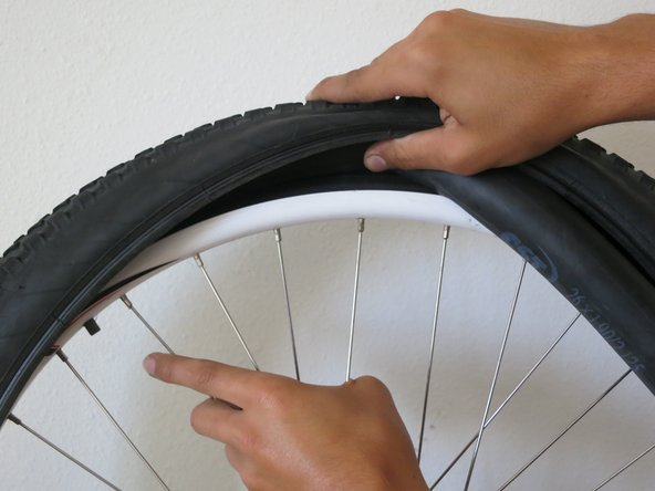 A valve stem is the metal/rubber piece that sticks out of a bike tire's tube.