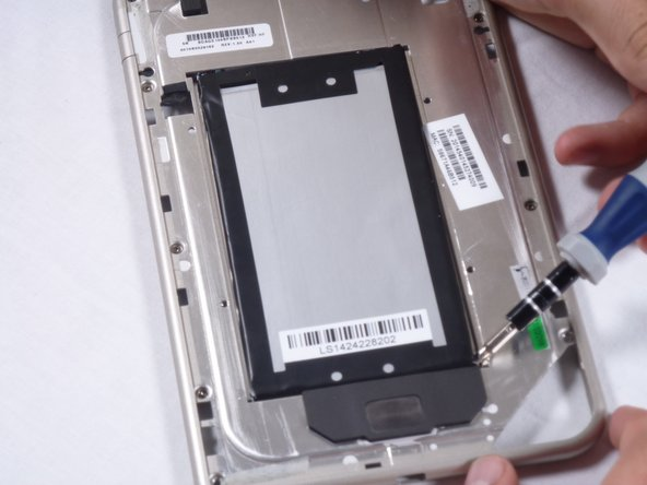 Set aside the motherboard and focus on the metal backing containing the battery.