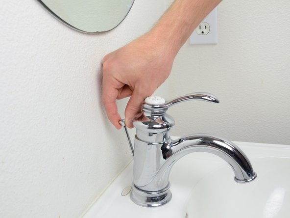 Pull up on the the pop-up drain stopper to seal the sink drain.