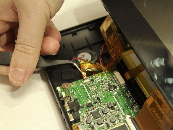 Carefully remove orange ribbons from the motherboard by opening the small plastic flaps and pulling with tweezers.
