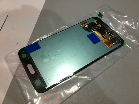 Attach the home button to the screen assembly. In this guide I am also installing a new screen assembly.