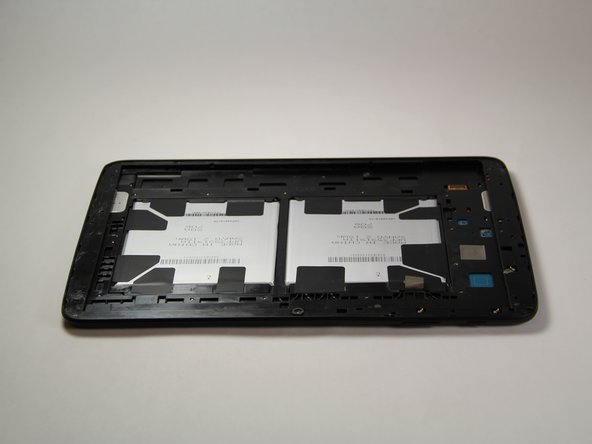 Now that the screen has been removed, clean up the remaining glue and glass shards around the edges of the device.