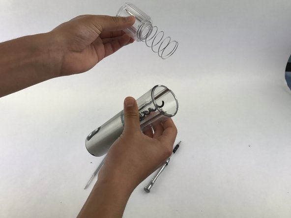 Image 1/1: Remove the spring guide as well to obtain clear access to the screws