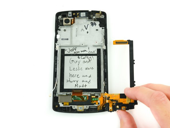 Image 3/3: Do not disconnect the daughterboard entirely. Gently fold it to the side of the phone.