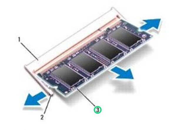 Use your fingertips to carefully spread apart the securing clips on each end of the memory-module connector until the memory module pops up.