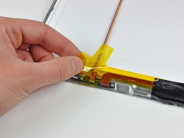 Image 1/1: Hold the iSight cable down as you peel back the tape. It is not necessary to completely remove the tape.
