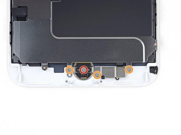 Dévissez les quatre vis Y000 fixant le cache recouvrant le capteur home/Touch ID: