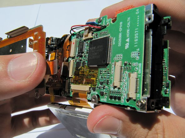 Pull the second orange tab from the circuit board and remove the buttons.