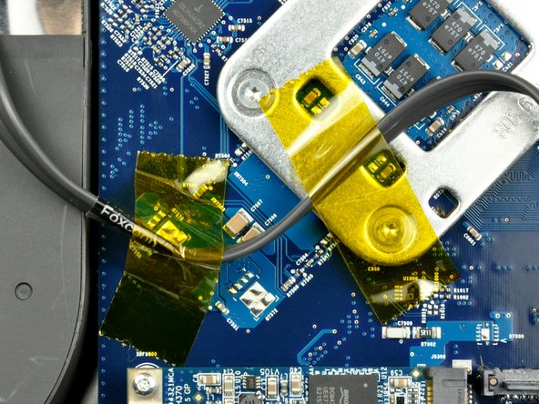 Image 1/1: If necessary, remove the pieces of tape holding the SATA data cable to the logic board.