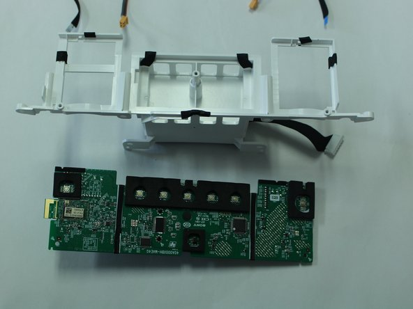 Remove the PH-1 screws (10 mm) from the motherboard to detach it from the outer white casing.