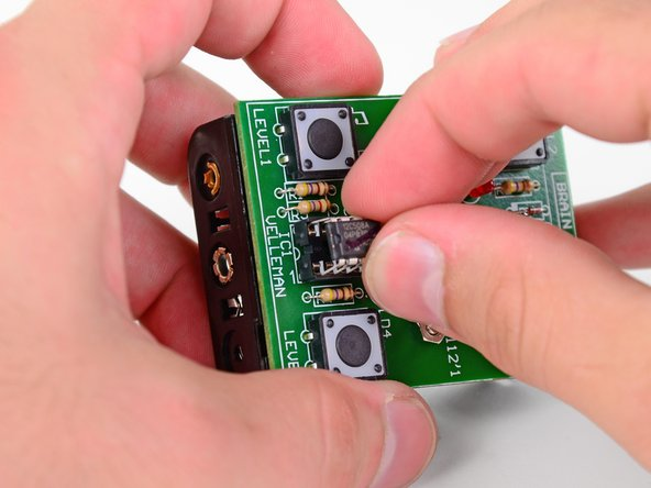Image 2/3: Install the CPU by pressing the eight pins into their respective holes in the IC socket.