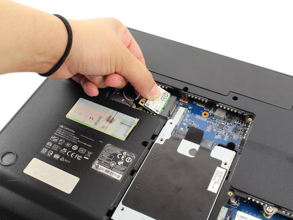Gently, remove the Wifi card from its slot, and place it in a dry and safe place.