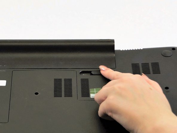 Slide the battery release latch to the left which is located on the right-hand side of the battery.