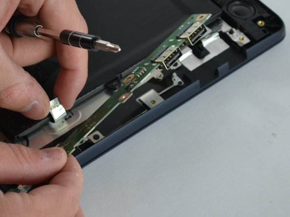 Carefully remove the USB ports from the laptop.