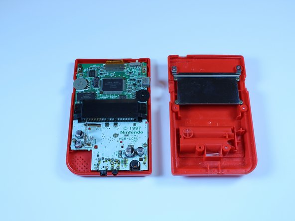 Image 2/3: Set the back cover aside. You will need it to reassemble the device