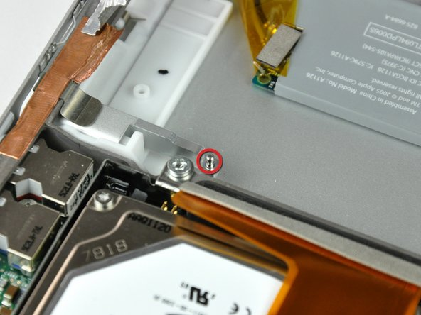 When reinstalling your PC card cage, be sure to insert the post sticking up from the PC card release button into the hole in the black plastic release mechanism on the PC card cage.