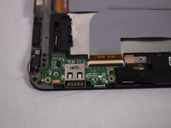 After disconnecting all the pieces, remove the USB port circuit board with your fingers
