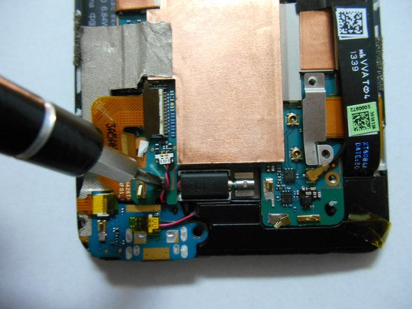 Image 3/3: Remove the screw using a Philips screwdriver.